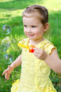 Portrait of little girl blowing soap bubbles Royalty Free Stock Photos