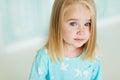 Portrait of a little girl in a blue dress