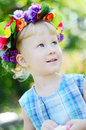 Portrait of a little girl blue eyed with flowerwreath Stock Photo