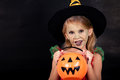 Portrait of little girl in costume witch on Halloween Royalty Free Stock Photo