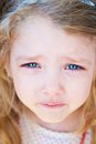 Portrait of little girl crying with tears Stock Photo