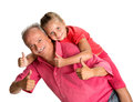 Portrait of a little girl enjoying piggyback ride with her grand grandfather on white background Stock Photo