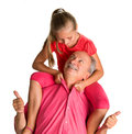Portrait of a little girl enjoying piggyback ride with her grand grandfather on white background Stock Photography