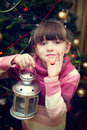 Portrait of little girl in front of Christmas tree Stock Photos