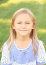 Portrait of little girl with long blond hair soft smile and blue eyes Royalty Free Stock Photos