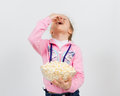 Portrait of a little girl with popcorn Royalty Free Stock Photo