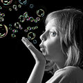 Portrait of little girl with soap bubbles Royalty Free Stock Photography