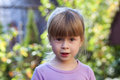 Portrait of little girl with surprised expression on face Royalty Free Stock Photo