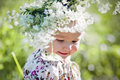 Portrait of little girl with wreath in a field flowers Royalty Free Stock Image