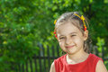 Portrait of little girl young preschool age against green lawn with fence Stock Images