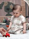 Portrait of a little kid with toy car Stock Photography