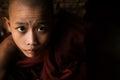 Portrait of little monk a low light inside temple Stock Photography