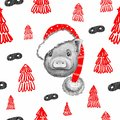 Portrait of a little piglet in a red Santa Claus hat