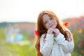 Portrait of little redhead girl outdoors in summer Royalty Free Stock Photo