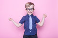 Portrait of a little smiling boy in a funny glasses and tie. School. Preschool. Fashion. Studio portrait over pink background Royalty Free Stock Photo