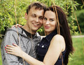 Portrait of love couple embracing outdoor in park Royalty Free Stock Photography