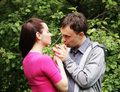 Portrait of love couple embracing outdoor in park looking happy Stock Image
