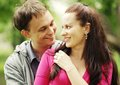 Portrait of love couple embracing outdoor in park looking happy Stock Photography