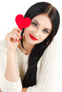 Portrait of love and valentines day woman holding heart smiling beautiful gorgeous with glamourous bright makeup red isolated on Royalty Free Stock Photography
