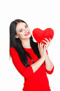 Portrait of love and valentines day woman holding heart smiling beautiful gorgeous with glamourous bright makeup red isolated on Stock Images