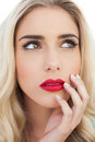 Portrait of a lovely blonde model looking away on white background Royalty Free Stock Images