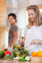 Portrait of a lovely couple making a salad Royalty Free Stock Image