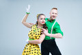 Portrait lovely funny dancer couple dressed in boogie woogie rock n roll pin up style posing together studio woman yellow Stock Photography