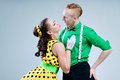 Portrait lovely funny dancer couple dressed in boogie woogie rock n roll pin up style rocknroll posing together studio woman Stock Image