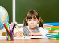 Portrait of lovely girl drawing in copybook Royalty Free Stock Photo