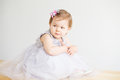 Portrait of a lovely little girl wearing elegant gray dress Royalty Free Stock Photo