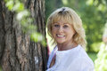 Portrait of lovely middle aged woman in the summer park close up Royalty Free Stock Image