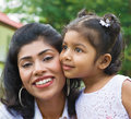 Portrait of loving mother and daughter indian family outdoor at garden park Royalty Free Stock Photo