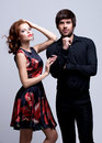 Portrait of luxury young couple in love posing at studio dressed classic clothes Stock Photo