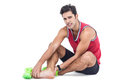 Portrait of male athlete with foot pain on white background Royalty Free Stock Photo
