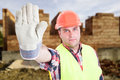 Portrait of male builder doing stop sign