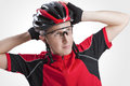 Portrait of Male Caucasian Cyclist Posing in Red Road Protective Helmet and Glasses. Royalty Free Stock Photo