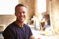 Portrait Of Male Designer Working At Desk In Modern Office