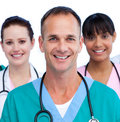Portrait of a male doctor and his medical team Royalty Free Stock Photo
