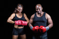 Portrait of male and female boxers with gloves Royalty Free Stock Photo
