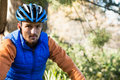 Portrait of male mountain biker in the forest Royalty Free Stock Photo