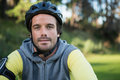 Portrait of male mountain biker riding bicycle in the forest Royalty Free Stock Photo