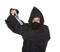 Portrait of male ninja with weapon isolated over white background Royalty Free Stock Photo