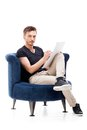 Portrait of a male sitting on chair young Royalty Free Stock Photography