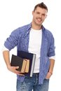 Portrait of male student with books smiling Royalty Free Stock Photo