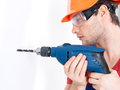 Portrait man drilling hole wall Royalty Free Stock Photos