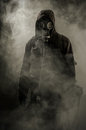 Portrait of a man in a gas mask smoke after the crash Royalty Free Stock Photo