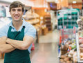 Portrait of man grocer smiling with his arms crossed Royalty Free Stock Photos