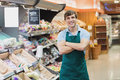 Portrait of man grocer smiling with his arms crossed Royalty Free Stock Image