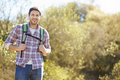 Portrait of man hiking in countryside wearing backpack Royalty Free Stock Photography