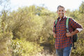 Portrait of man hiking in countryside wearing backpack Stock Photos